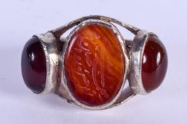 A LARGE VINTAGE MIDDLE EASTERN ISLAMIC SILVER CALLIGRAPHY AGATE RING. W/X.