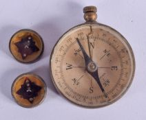 A VINTAGE COMPASS and similar miniature compass. (3)