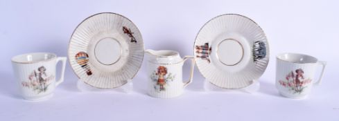 AN UNUSUAL PAIR OF EDWARDIAN CUPS AND SAUCERS decorated with figures and hot air balloons. (5)