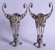A PAIR OF ANTIQUE CONTINENTAL WHITE METAL VASES. 284 grams. 21 cm high.