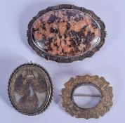 AN ANTIQUE SILVER MOUNTED MOURNING BROOCH and another. Largest 4 cm x 5 cm. (2)
