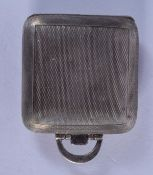 A 1930S SILVER TRAVELLING SQUARE FORM WATCH. 3.5 cm square.