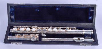 A STERLING SILVER CASED FLUTE BY Trevor James of London. 420 grams. 70 cm long.