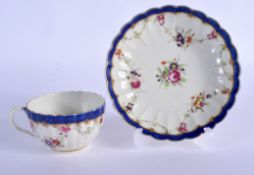18th c. Worcester fluted teacup and saucer painted with swags of flowers around a central bouquet bo