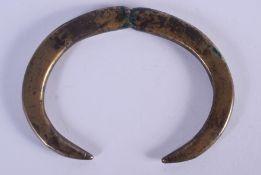 A LATE BRONZE AGE HALLSTATT CULTURE BOARS TUSK BRONZE PENDANT 800 – 600 BCE. 11 cm wide.