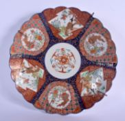 A 19TH CENTURY JAPANESE MEIJI PERIOD SCALLOPED DISH painted with figures and Buddhistic lions. 30 cm