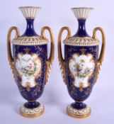 Royal Worcester good pair of vases painted with exotic birds in landscape in the manner of George Jo