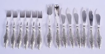 A SET OF VINTAGE WHITE METAL FISH KNIVES AND FORKS. 350 grams. (qty)