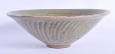 A CHINESE CELADON BOWL 20th Century. 18 cm diameter.