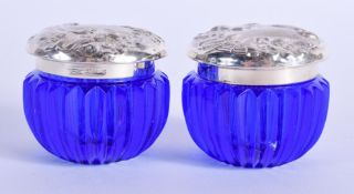 TWO SILVER TOPPED BRISTOL BLUE JARS. 4.5 cm wide.