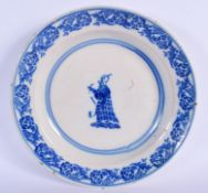 A LARGE 19TH CENTURY CONTINENTAL BLUE AND WHITE DISH sponge decorated with a Chinaman. 33 cm diamete