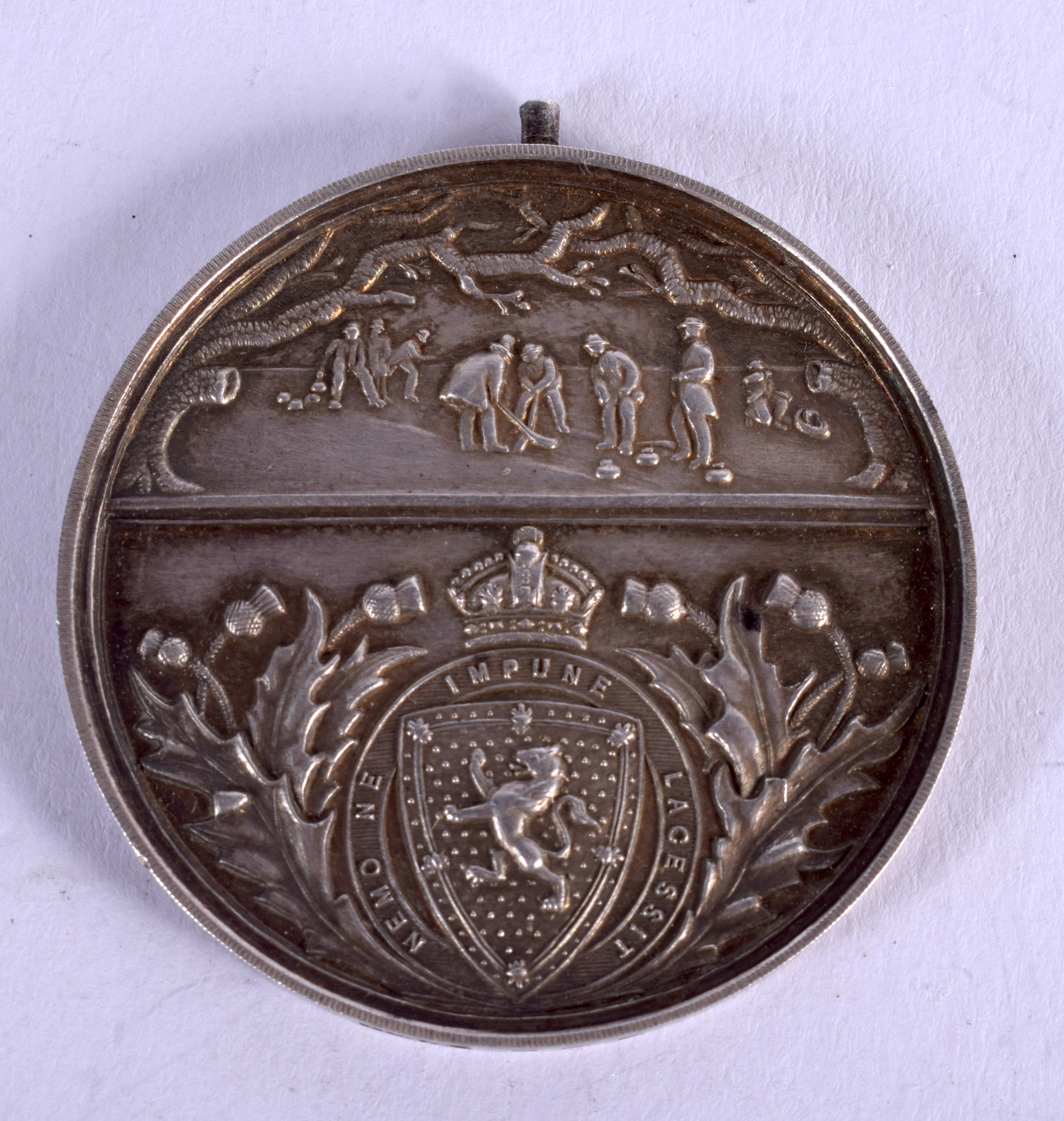 AN ANTIQUE ROYAL CALEDONIAN CURLING MEDAL. 26 grams. 4.5 cm wide.