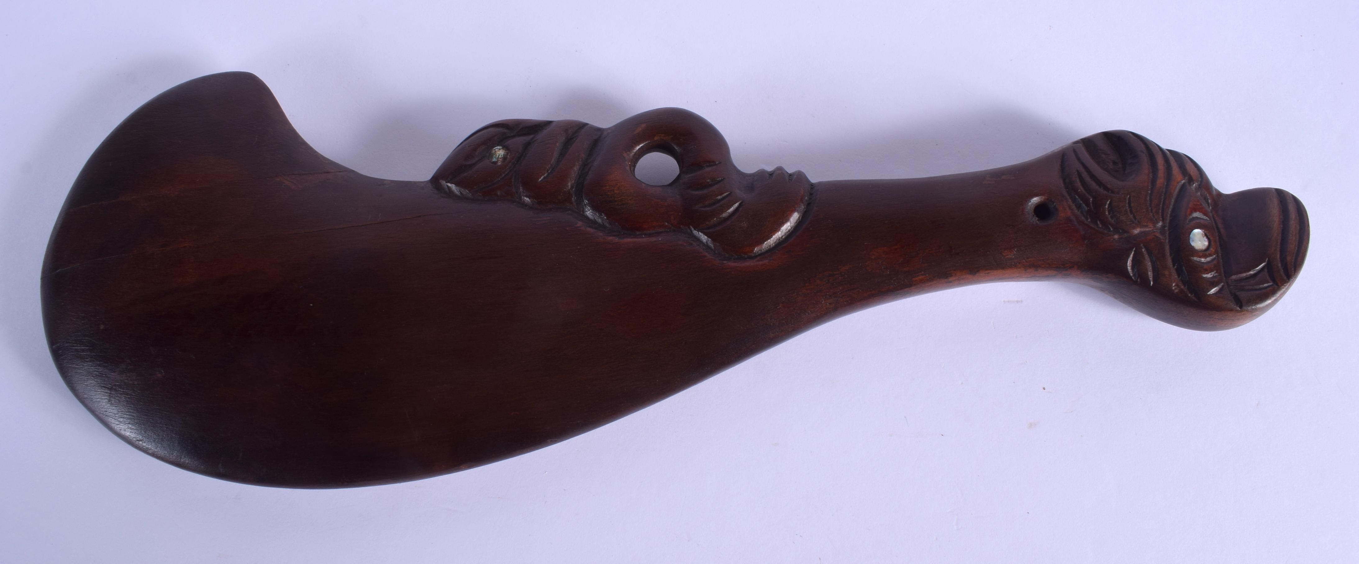 A TRIBAL MAORI PATU CLUB. 36 cm long.
