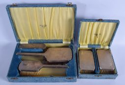 FIVE CASED 1950S SILVER BACK BRUSHES. Birmingham 1954. 700 grams overall. (5)