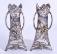 A STYLISH PAIR OF ART NOUVEAU WMF SILVER PLATED VASES decorated with musicians. 18.5 cm high.
