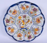 A LARGE 19TH CENTURY DUTCH DELFT FAIENCE TIN GLAZED DISH painted with birds. 30 cm wide.