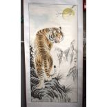 A CHINESE WATERCOLOUR SCROLL PAINTING Attributed to Gao Ru Song, a tiger in a landscape. 127 cm x 61