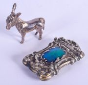 AN ENGLISH SILVER DONKEY together with an enamelled vesta. (2)