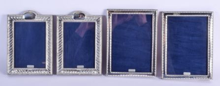TWO PAIRS OF SILVER PHOTOGRAPH FRAMES. 22 cm x 12 cm. (4)