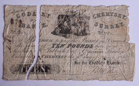 A RARE ANTIQUE GODLEY BANK CHERTSEY SURREY TEN POUND BANK NOTE. 19 cm wide.