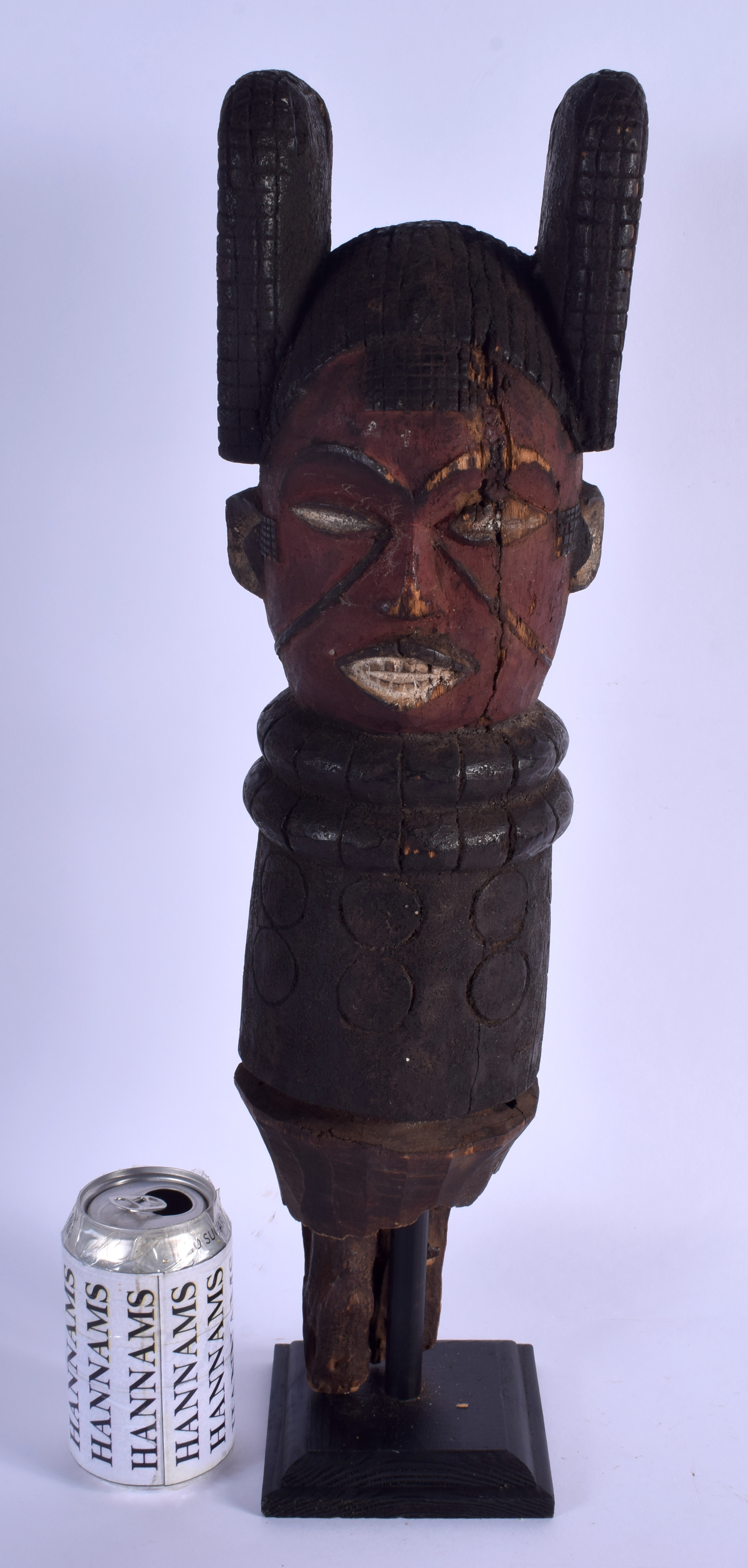 A LARGE TRIBAL POLYCHROMED WOODEN MASK. 49 cm high.