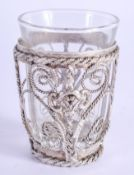 A SMALL VINTAGE WHITE METAL CASED SHOT GLASS. 7 cm high.