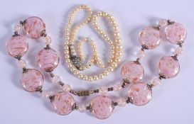 A GLASS NECKLACE and another. (2)