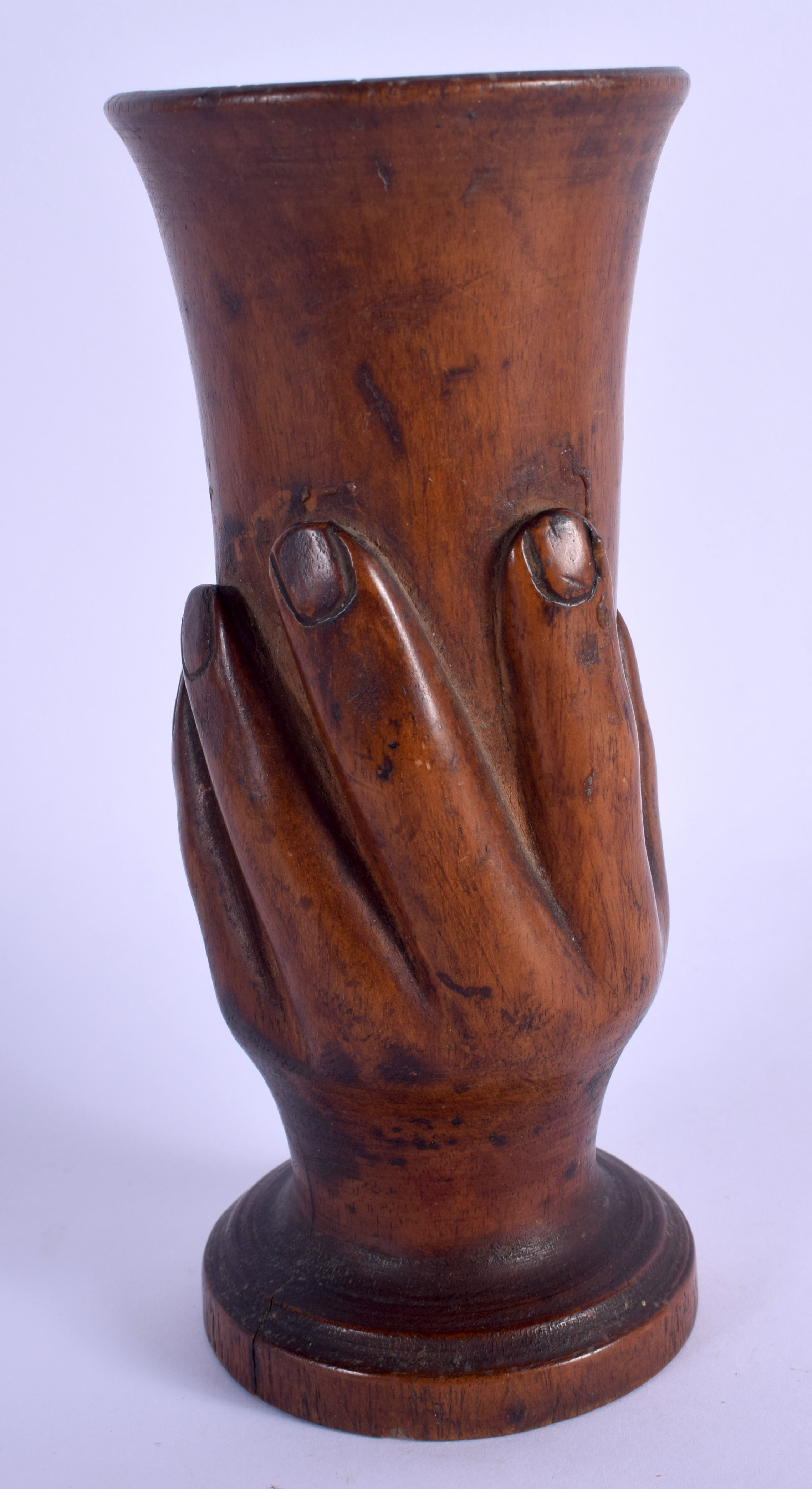 A RARE PITCAIRN ISLANDS CARVED WOOD VASE formed with an open hand. 19 cm high.