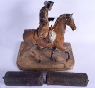 AN ANTIQUE CAST IRON PAINTED HORSE together with a pair of clock weights. Largest 30 cm x 25 cm. (3)