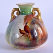 Royal Worcester two Handled vase painted with a brace of pheasants in a tree by Reginald Austin, sig