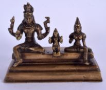 A 19TH CENTURY MIDDLE EASTERN INDIAN BRONZE FIGURE OF BUDDHISTIC DEITIES. 15 cm x 12 cm.