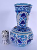 A LARGE PERSIAN SAFAVID FAIENCE GLAZED POTTERY VASE painted with flowers. 33 cm x 15 cm.