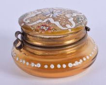 A SMALL ANTIQUE ENAMELLED GLASS BOX. 4 cm wide.