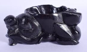 AN EARLY 20TH CENTURY CHINESE CARVED BLACK STONE BRUSH WASHER. 9 cm x 6 cm.