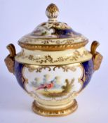 Late 19th/Early 20th c. Coalport pot pourri vase and cover painted with four panels each having a bi