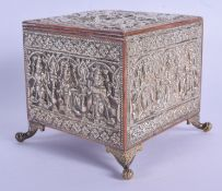 A 19TH CENTURY INDIAN SILVER OVERLAID CASKET decorated with Buddhistic figures. 12 cm x 9 cm.
