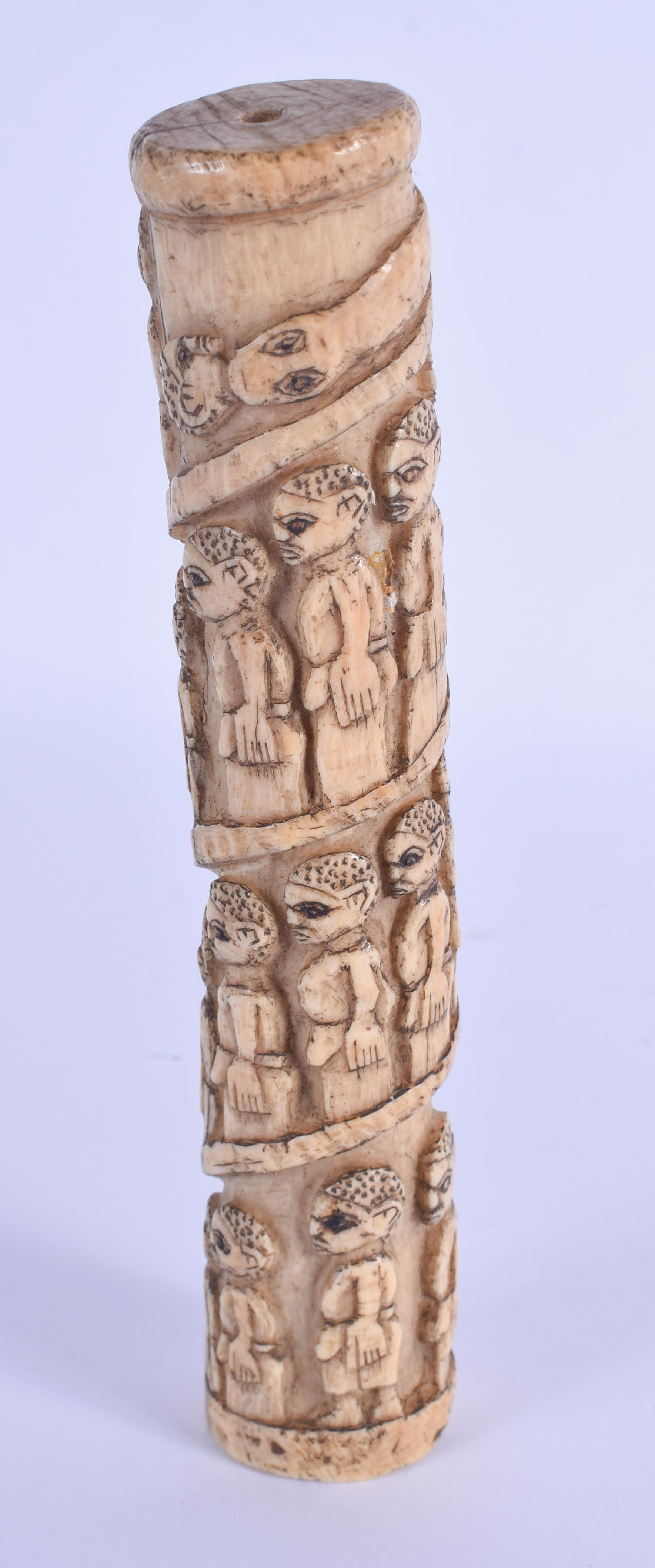 A 19TH CENTURY AFRICAN TRIBAL CARVED BONE PROCESSIONAL POUNDER decorated with figures. 18 cm high. - Image 2 of 3