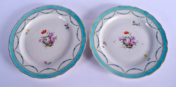 18th c. pair of Chelsea Derby plates with a turquoise border, garlands of husks and a large central