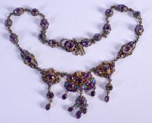 A LOVELY ANTIQUE SILVER ENAMEL AUSTRIAN AMETHYST NECKLACE decorated with foliage and vines. 50 grams