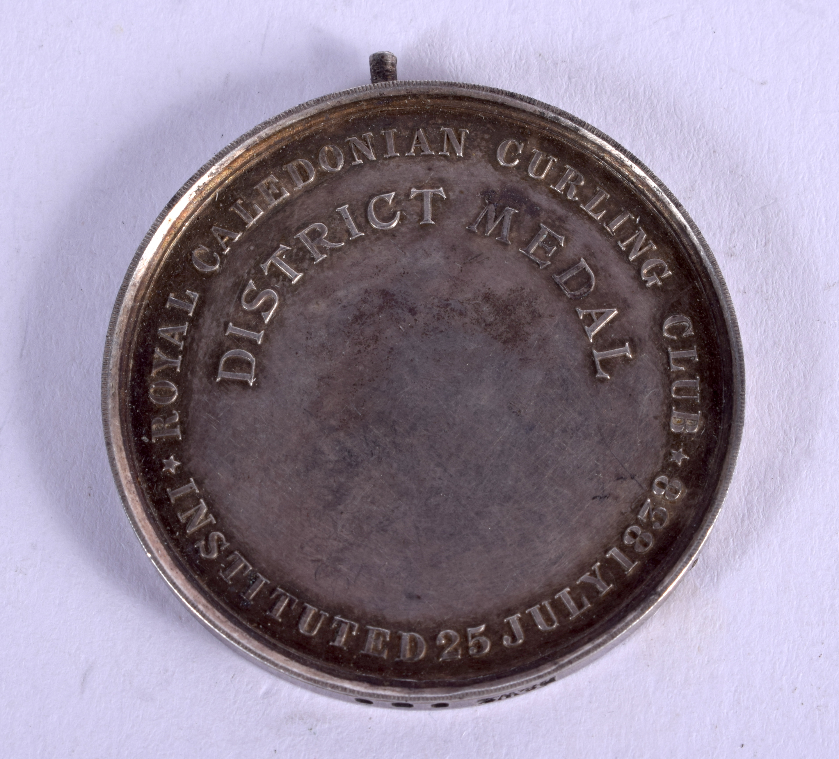 AN ANTIQUE ROYAL CALEDONIAN CURLING MEDAL. 26 grams. 4.5 cm wide. - Image 2 of 2
