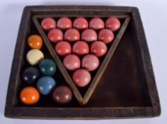 A SET OF BILLIARD BALLS within a case. (qty)