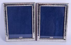 A PAIR OF SILVER PHOTOGRAPH FRAMES. 23 cm x 17 cm.
