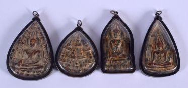 FOUR UNUSUAL SOUTH EAST ASIAN SILVER MOUNTED ICONS. (4)