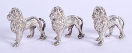 THREE VINTAGE WHITE METAL LIONS. 102 grams. 3 cm x 3 cm. (3)