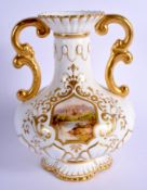 Coalport two handled vase painted with a landscape of a lake and abbey ruins on a moulded and raised