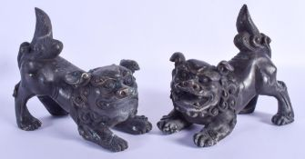 A PAIR OF CHINESE BRONZE BUDDHISTIC DOGS OF FOE 20th Century. 16 cm x 11 cm.