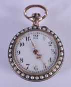 AN EDWARDIAN SILVER PEARL AND ENAMEL FOB WATCH. 18.9 grams. 2.75 diameter.