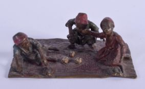 A COLD PAINTED BRONZE GROUP OF ARABIC CHILDREN. 8 cm x 5.5 cm.