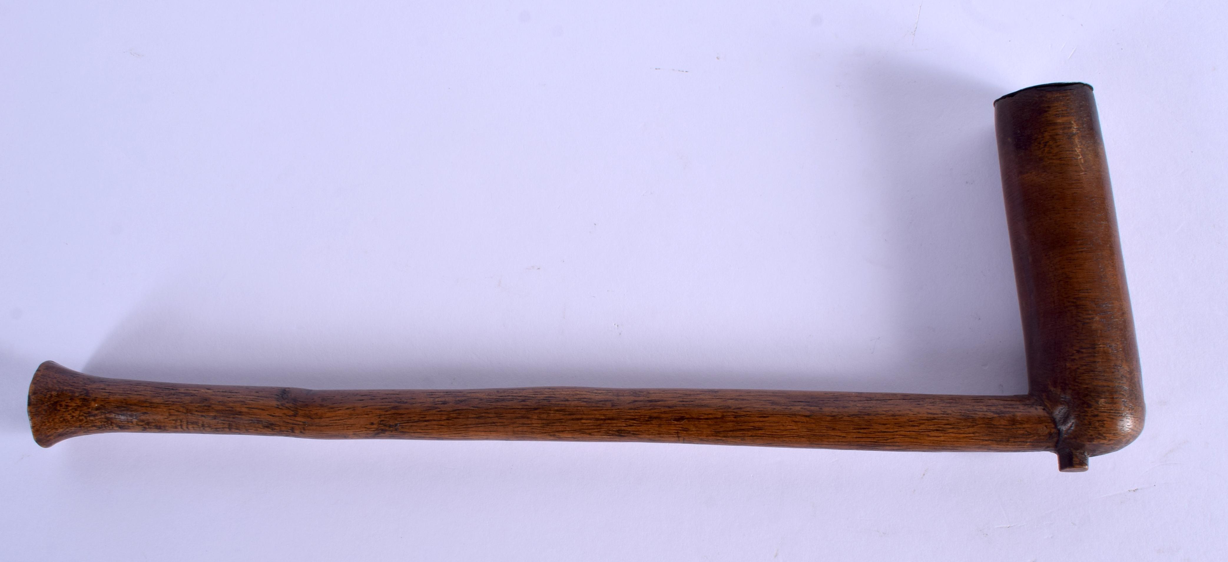 A TRIBAL ZULU PIPE. 25 cm wide.