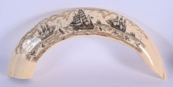 A LARGE CONTINENTAL SCRIMSHAW STYLE CARVING decorated with whaling scenes. 36 cm wide.